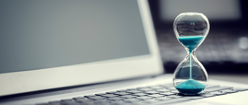 image of hourglass on a laptop