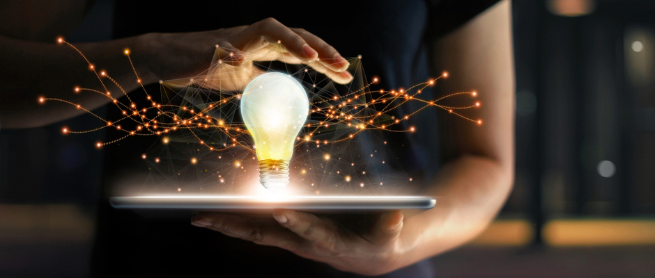 image of light bulb coming out of ipad to represent a new idea