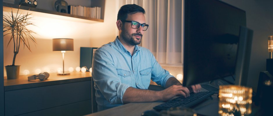image of man working at a desk