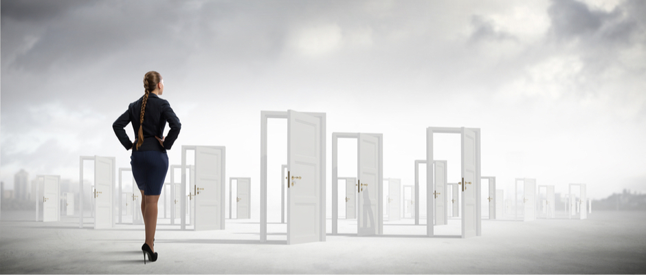 image of business woman looking at many open doors