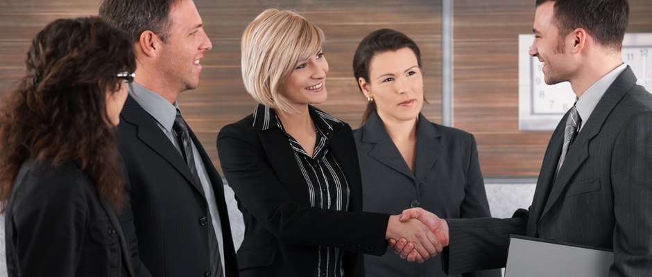 image of business woman shaking hands with business man